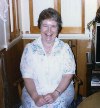 Mom laughing in Kitchen